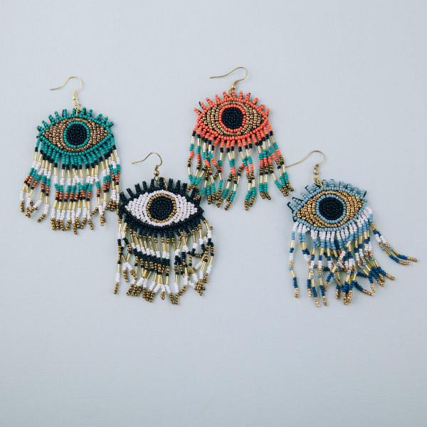 """Seed beaded evil eye tassel dangle earrings. Approximately 3"""" in length."""