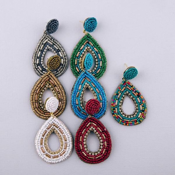 "Seed beaded cut out felt teardrop boho earrings with rhinestone details. Approximately 3"" in length."
