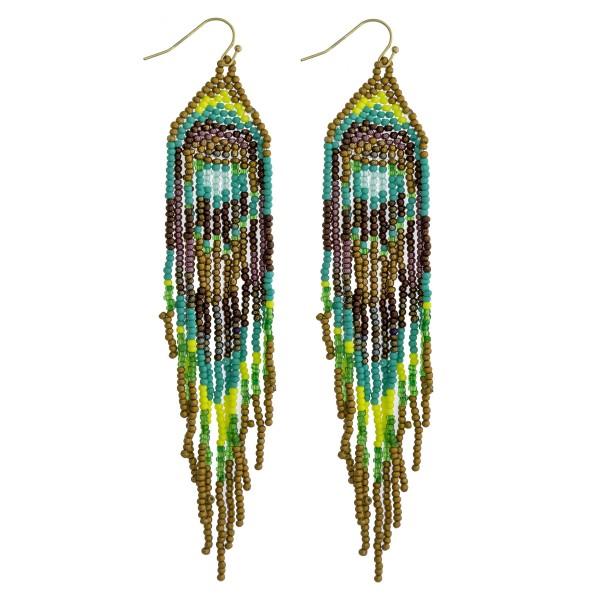 "Multicolor seed beaded boho tassel earrings. Approximately 4.75"" in length."