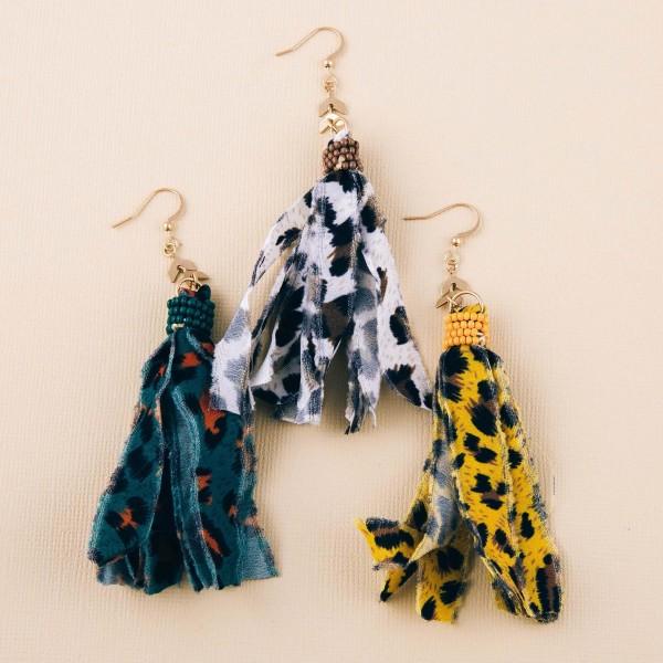 """Leopard print fabric tassel dangle earrings. Approximately 3.5"""" in length."""