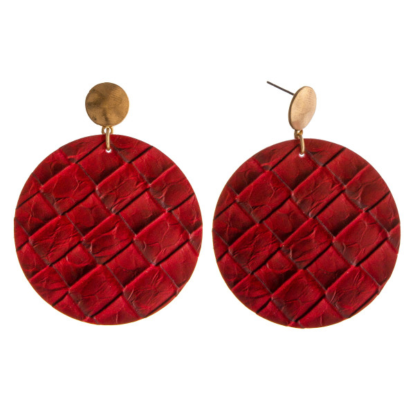 "Faux leather disc dangle earrings. Approximately 2"" in diameter and 2"" in length."