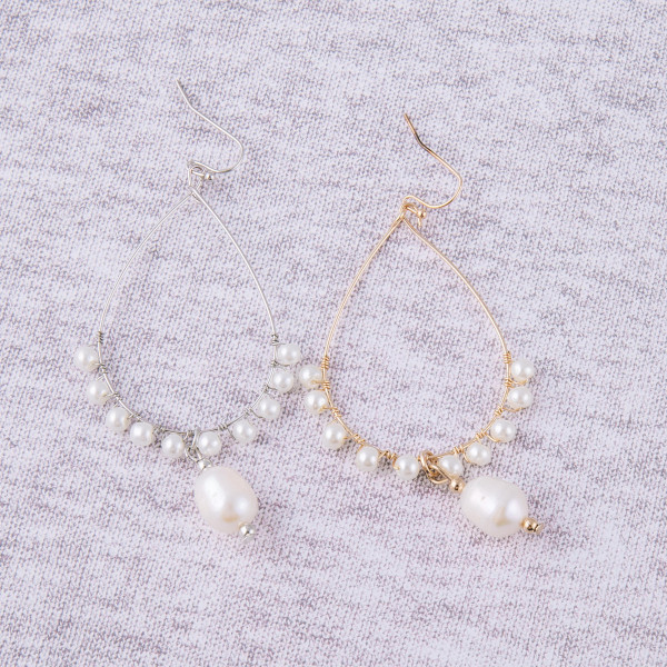 """Pearl beaded teardrop dangle earrings. Approximately 3"""" in length."""