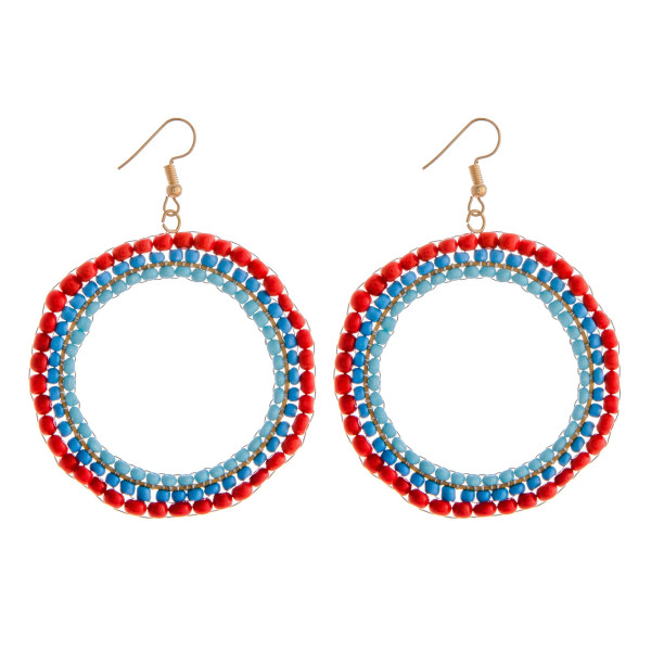 "Brick stitched multicolor beaded dangle earrings. Approximately 2"" in diameter, 3"" in length."