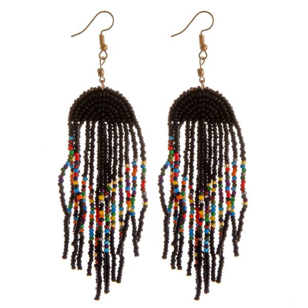 "Seed beaded tassel dangle earrings. Approximately 4"" in length."
