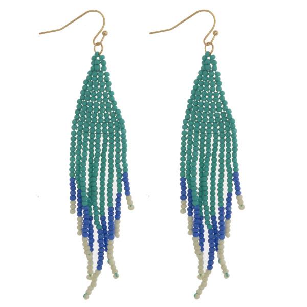 """Triangular seed beaded boho tassel earrings. Approximately 3"""" in length."""