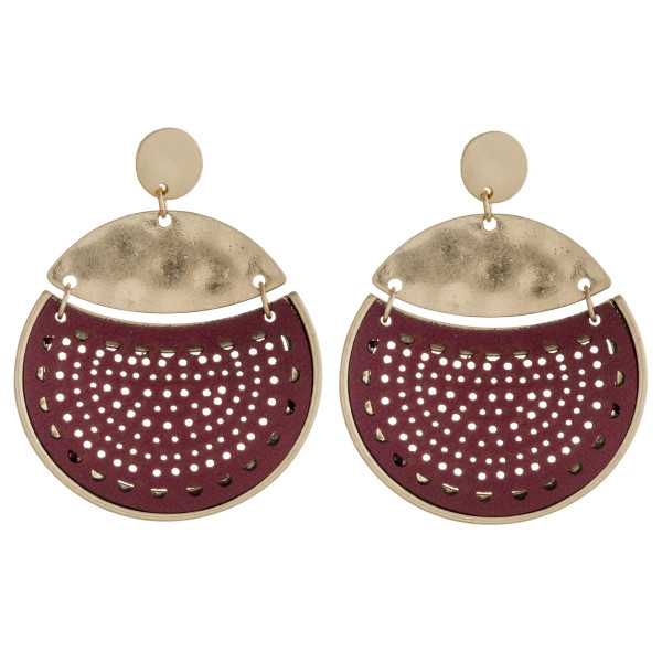 """Hammered metal hole punch faux leather encased disc earrings. Approximately 1.75"""" in diameter."""