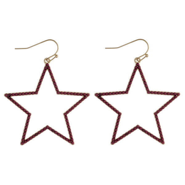 "Beaded metal star drop earrings. Approximately 2"" in length."