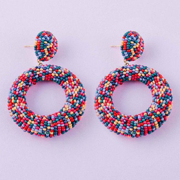 "Multicolor seed beaded open ring dangle earrings. Approximately 1.5"" in diameter."