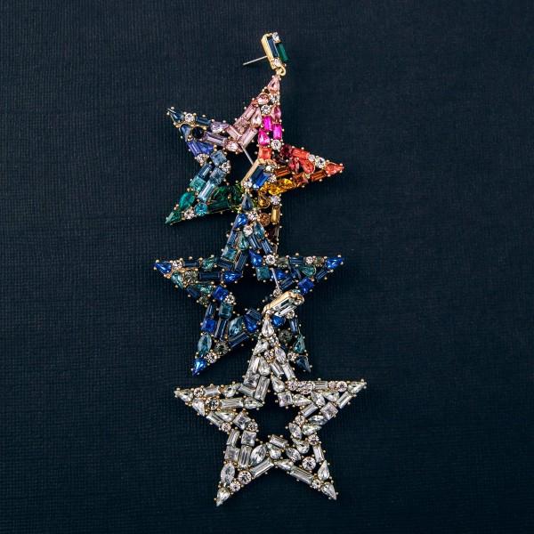 "Heavyweight rhinestone encased star drop earrings. Approximately 2.75"" in length."