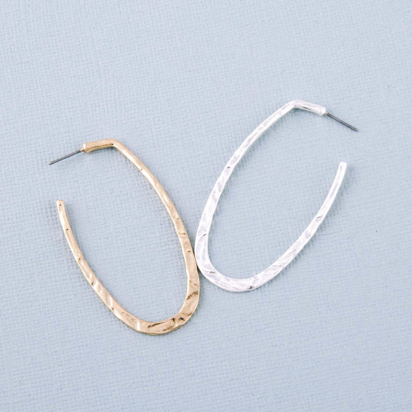 "Hammered oval open hoop earrings. Approximately 2.5"" in length."