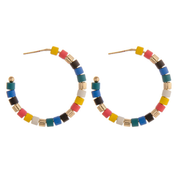 "Color block beaded open hoop earrings. Approximately 1.5"" in diameter."