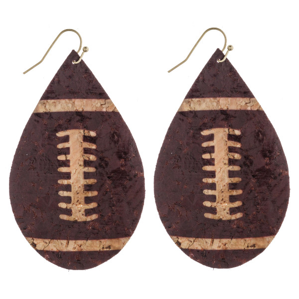 "Thin cork football teardrop earrings. Approximately 3"" in length."