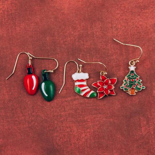 "Enamel coated Christmas poinsettia dangle earrings. Approximately .75"" in length."