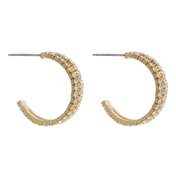 "Cubic zirconia open hoop earrings. Approximately .75"" in diameter."