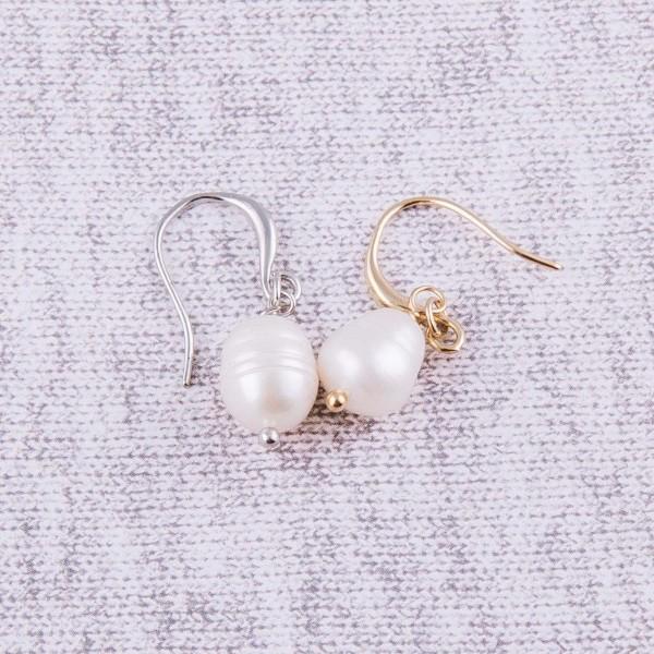 "Freshwater pearl dangle earrings. Approximately 1"" in length."
