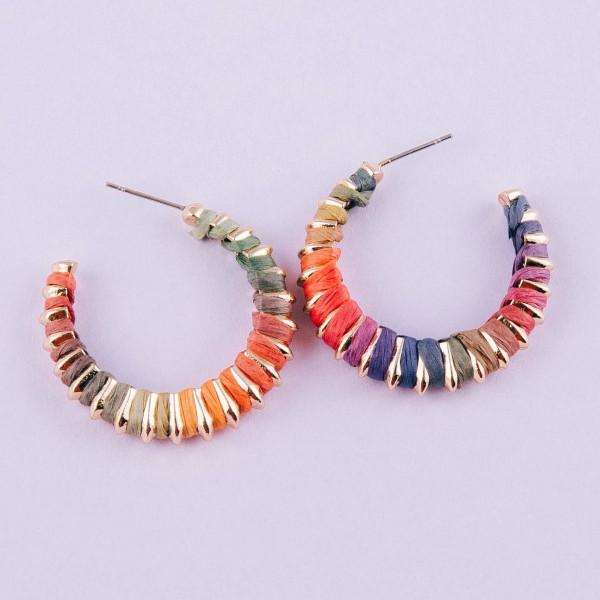 """Multicolor raffia wrapped open hoop earrings. Approximately 1"""" in diameter."""
