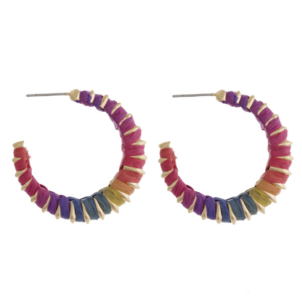 "Multicolor raffia wrapped open hoop earrings. Approximately 1"" in diameter."