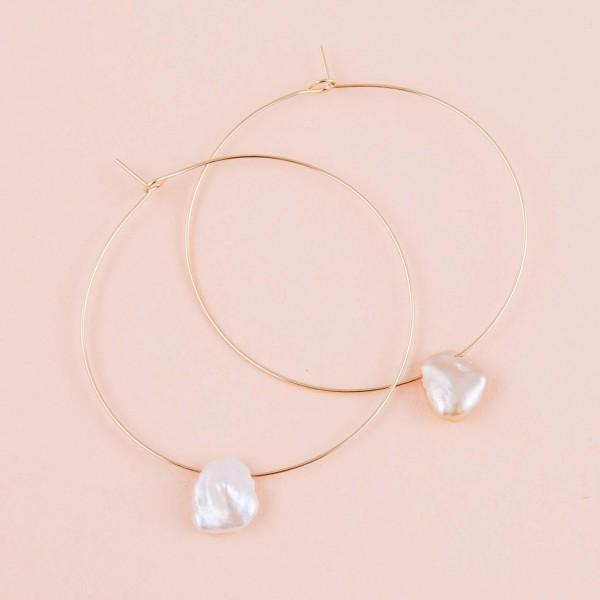 "Thin wire freshwater pearl hoop earrings. Approximately 1.75"" in diameter."
