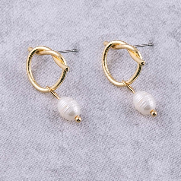 """Gold knotted faux pearl dangle stud earrings. Approximately 1"""" in length."""