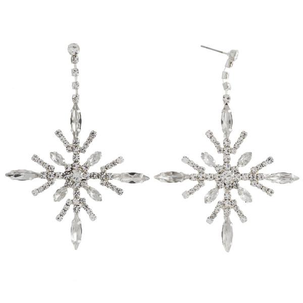 "Rhinestone cubic zirconia rhinestone winter snowflake dangle earrings. Approximately 3"" in length."