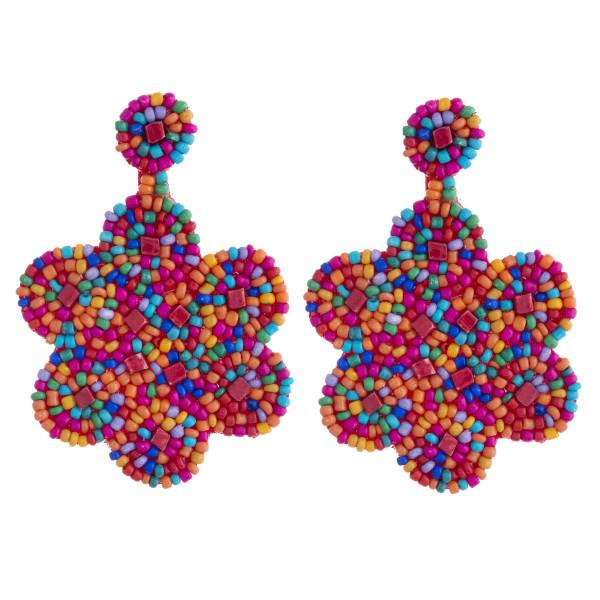"""Seed beaded felt flower dangle earrings. Approximately 2.5"""" in length."""