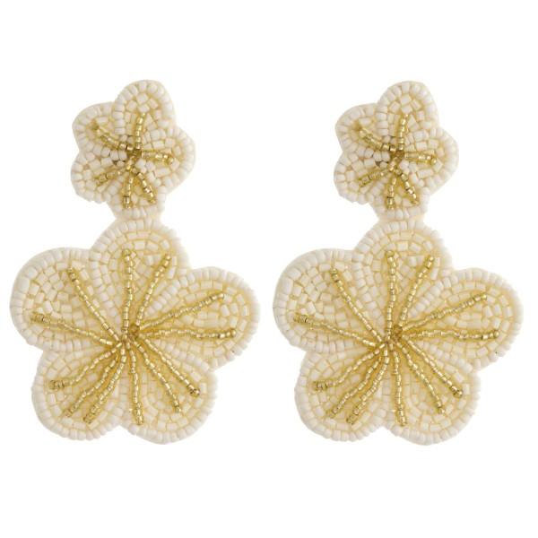 """Seed beaded felt flower dangle earrings. Approximately 3"""" in length."""