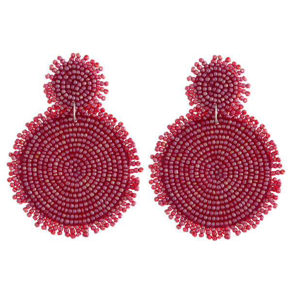 "Seed beaded felt disc earrings featuring short tassel accents. Approximately 3"" in length."