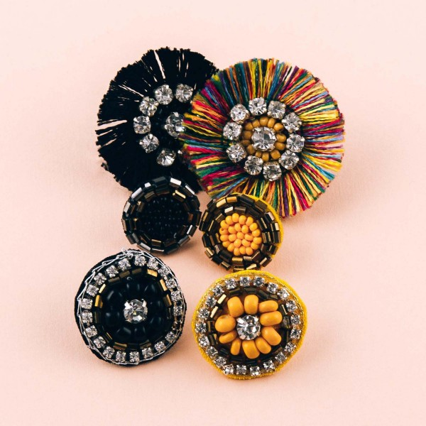 """Trio seed beaded felt disc earring set featuring rhinestone and tassel accents. Approximately .5"""" in diameter - 1"""" in diameter."""