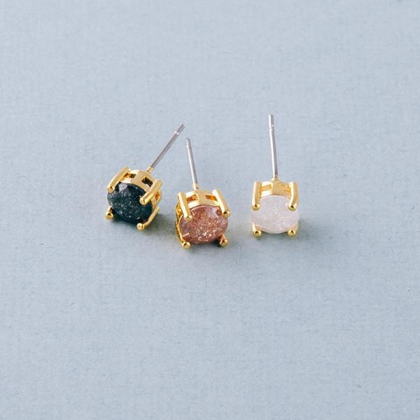 Round cubic zirconia stud earrings. Approximately .5cm in diameter.