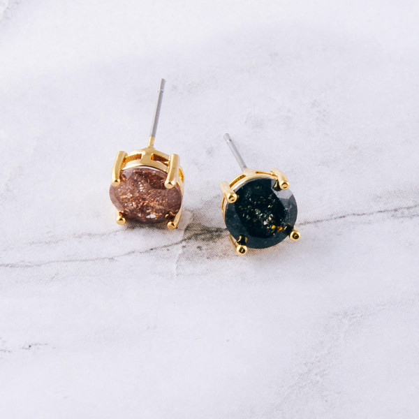 Round cubic zirconia stud earrings. Approximately 8mm in diameter.