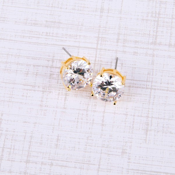 Round cubic zirconia stud earrings. Approximately 12mm in diameter.