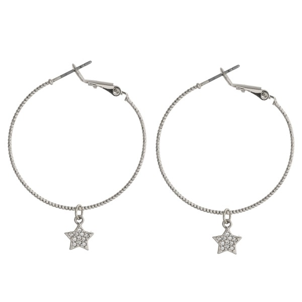 "Cubic zirconia star hoop earrings. Approximately 1.5"" in length."
