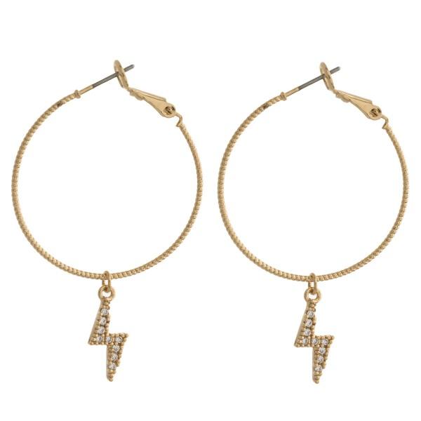 "Cubic zirconia lightning bolt hoop earrings. Approximately 2"" in length."