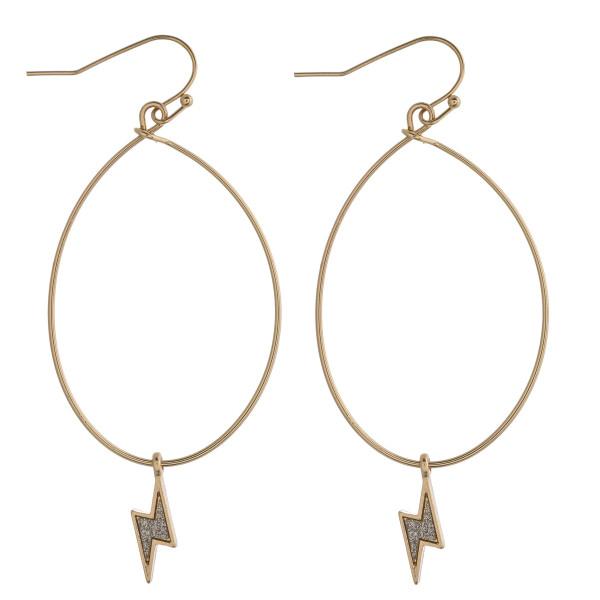 "Two tone glittery lightning bolt flexi wire dangle earrings. Approximately 2.5"" in length."
