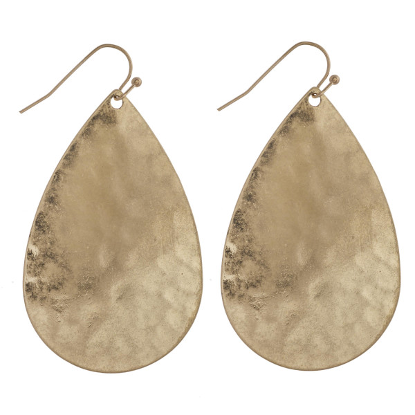 "Hammered metal teardrop earrings. Approximately 2.5"" in length."