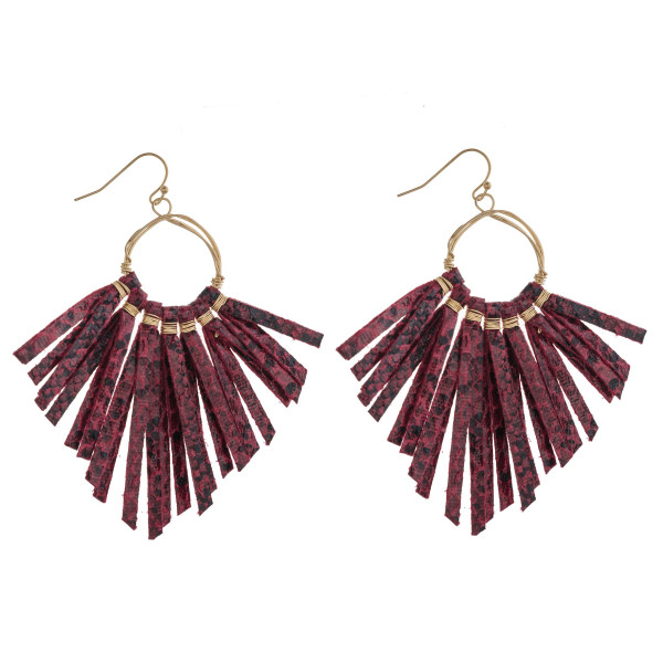 "Wire wrapped faux leather snakeskin tassel drop earrings. Approximately 3.25"" in length."