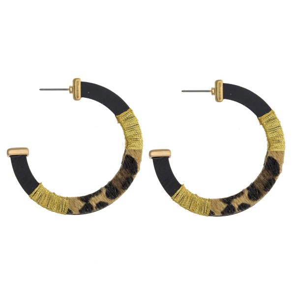 "Thread wrapped faux fur leopard print open hoop wood earrings. Approximately 2"" in diameter."