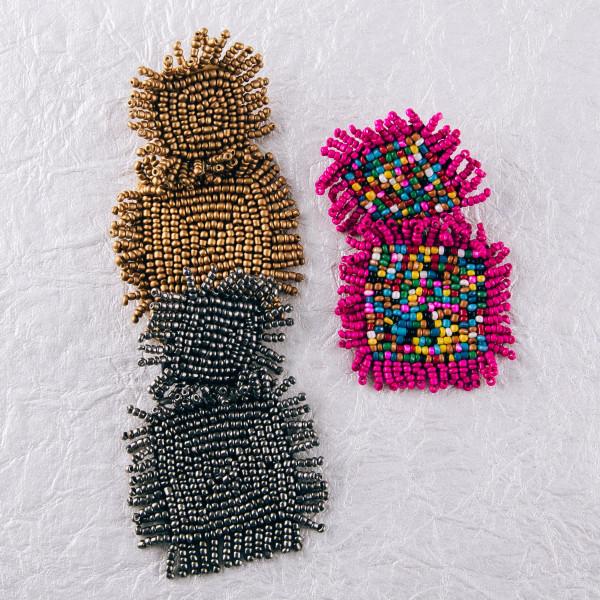 """Seed beaded felt block tassel drop earrings. Approximately 3"""" in length."""