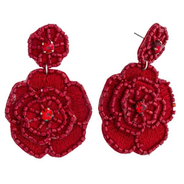 "Seed beaded felt flower blossom drop earrings. Approximately 2.5"" in length."