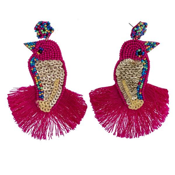 """Seed beaded sequin felt bird tassel earrings. Approximately 3.75"""" in length."""