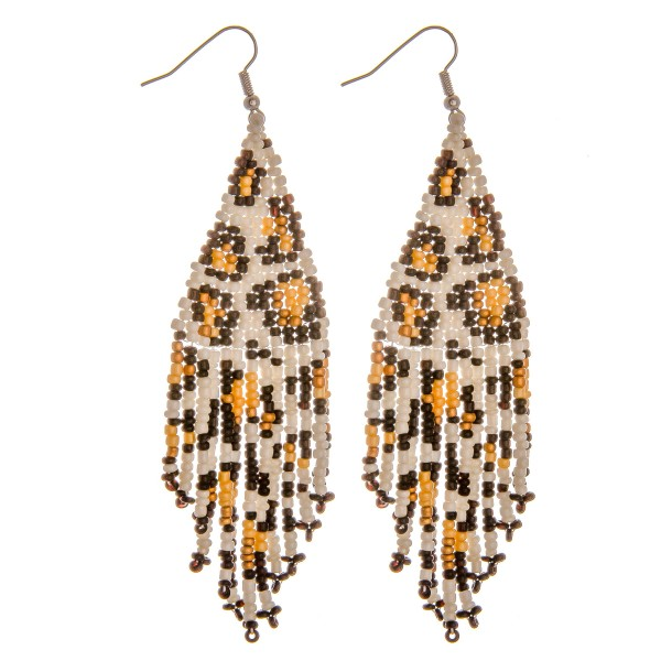 "Seed beaded leopard print tassel earrings. Approximately 4"" in length."