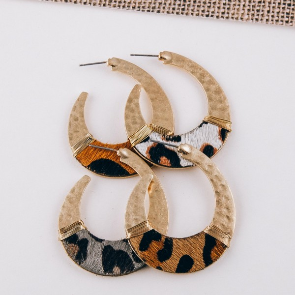 "Cowhide animal print hammered j-hoop earrings with wire wrapped details.  - Approximately 2"" in length"
