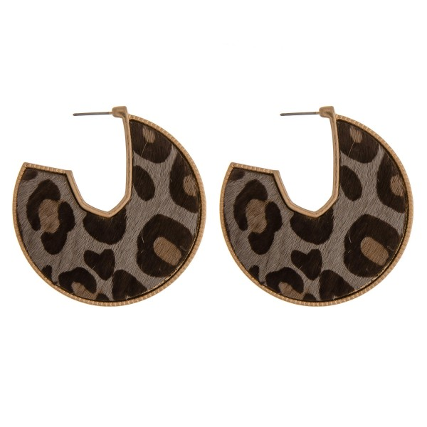 "Cowhide leopard print encased open hoop disc earrings.  - Approximately 2"" in diameter"