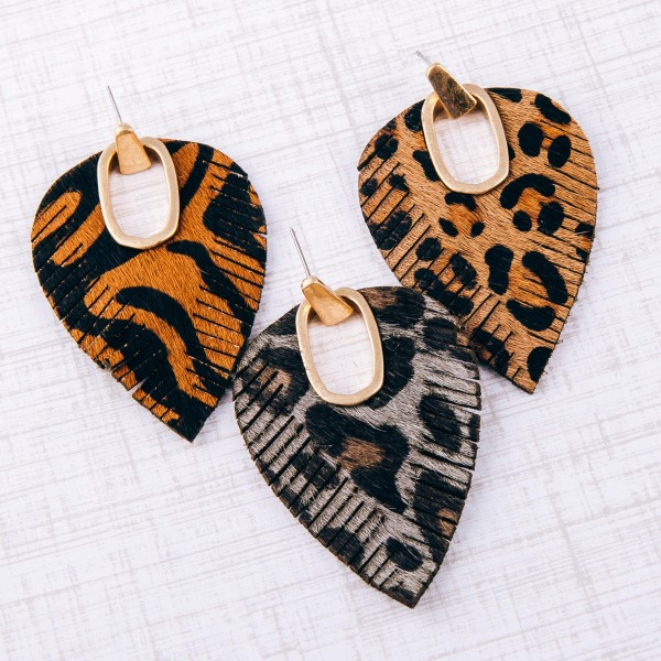"Faux leather cowhide animal print hinge cut out earrings.  - Approximately 2.75"" in length"