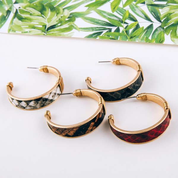 "Faux leather snakeskin hoop earrings with wire wrapped details.  - Approximately 1.5"" in diameter - Approximately 1cm in width"