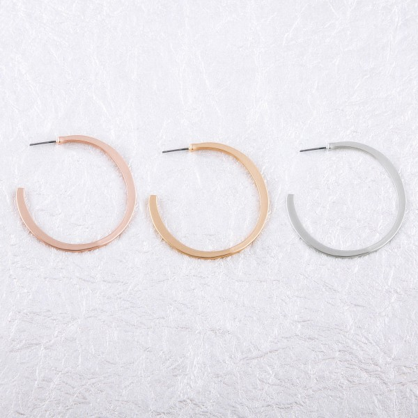 "Flat matte open hoop earrings.  - Approximately 2"" in diameter"