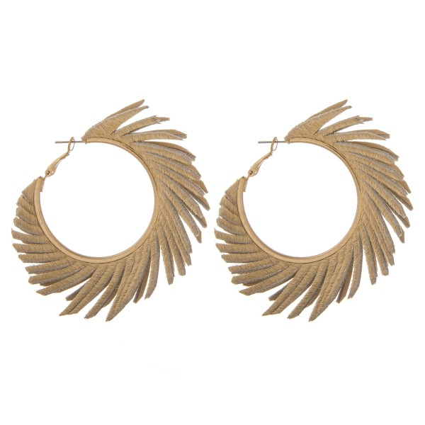 "Faux leather cowhide feather statement hoop earrings.  - Approximately 2.5"" in diameter"