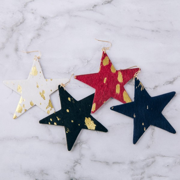 """Metallic cowhide star cut out earrings.  - Approximately 3"""" in length and size"""