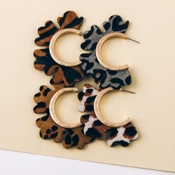 "Genuine leather leopard print flower cut out hoop earrings.  - Approximately 2"" in diameter"