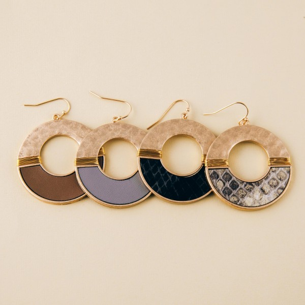 """Hammered metal snakeskin earrings with wire wrapped details.  - Approximately 2"""" in length and 1.5"""" in diameter"""